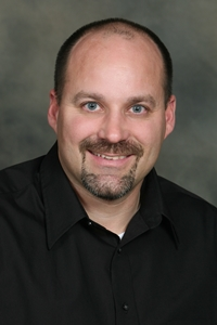 A professional headshot of a man, Physical Therapist and Therapy Services Department Manager Craig Curry