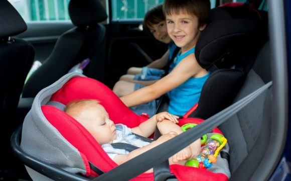 baby and boys in car seats